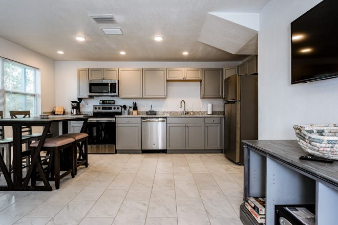 This updated beachside complex holds four units, including one with two bedrooms, one bathroom, a full-size open kitchen and living room.