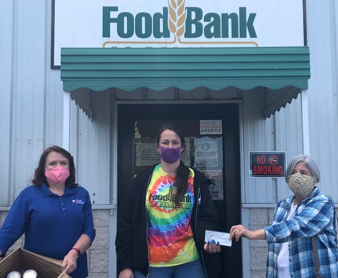 The Daughters of the American Revolution, Col. John Haslet Chapter of Dover presented a check for $425 and donated 34 pounds of nonperishable food items to the Food Bank of Delaware. Pictured, from left: Chapter Regent Donna Josefowski, Food Bank Warehouse Manager Melissa Holochwost and Chapter Treasurer Lorna McElhone-Thorogood.