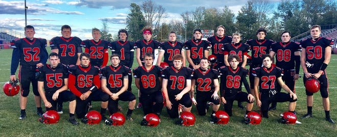 Honesdale kicked-off its 2020 Lackawanna Football Conference schedule Friday night with a lopsided loss at the hands of Scranton Prep. Pictured here are seniors who were honored in a ceremony prior to the game (first row, from left): Jacob Burlein, Jordan DeGroat, John Charpentier, Xander Davis, John Savage, Jacob Orrick, Brady Hanson, Nathaniel Hendrickson. Second row: Izaiah Sandy, Tanner Rowles, Joshua Stinavage, Peter West, Tyler Faithful, Jacob Egan, Timmy Dailey, Sam Deron, Trevor Reed, Geoffrey Johnson, Brady Carmody, Kane Rogers. [Kevin Edwards/Staff]