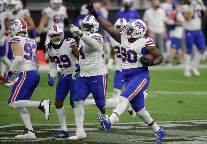 Buffalo Bills defensive tackle Quinton Jefferson (90) celebrates after recovering a fumble by the Las Vegas Raiders during the second half of an NFL football game, Sunday, Oct. 4, 2020, in Las Vegas. The Bills (4-0) will play the Tennessee Titans (3-0) on Tuesday night.