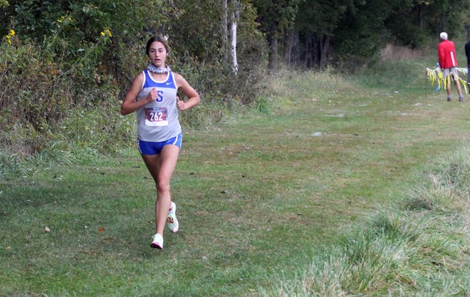 Blue Springs South's Mya Trober leads the first wave of the Kansas City Classic Saturday near Raymore-Peculiar High School. Trober claimed the girls individual title and led the Jaguars to the team title.