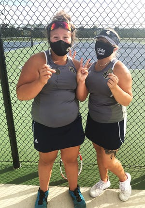 William Chrisman doubles team Tori Gant and Kiara Ashurst celebrate after finishing second in the Class 2 District 8 tournament and becoming the first Chrisman players to advance to the state tournament.
