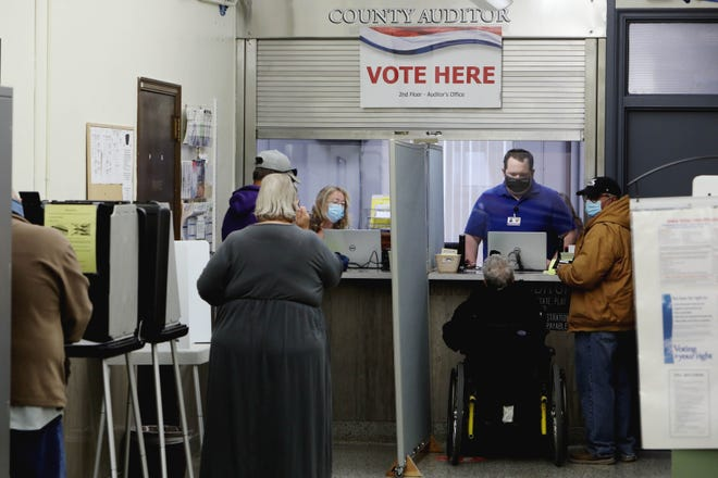 Workers at the Des Moines County Auditors office help early voters during the first day Iowa voters could go to their county auditor's offices to vote early in person Monday at the Des Moines County Courthouse in Burlington.