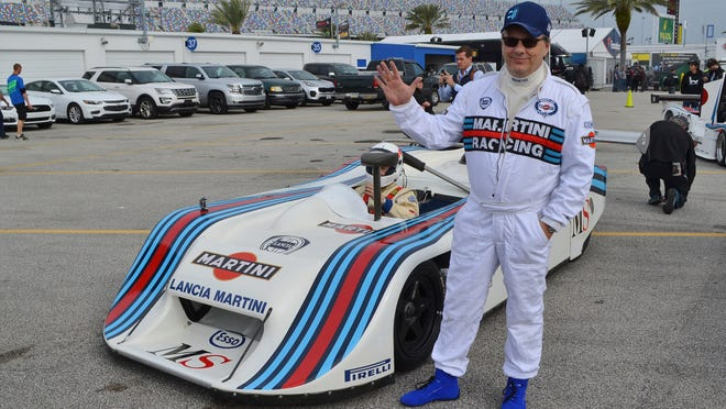 John Campion next to his 1982 Lancia LC1, with Andy Greene behind the wheel, before a high-speed exhibition of race cars at Daytona International Speedway before a recent Rolex 24 at Daytona. [Dan Scanlan/Florida Times-Union]