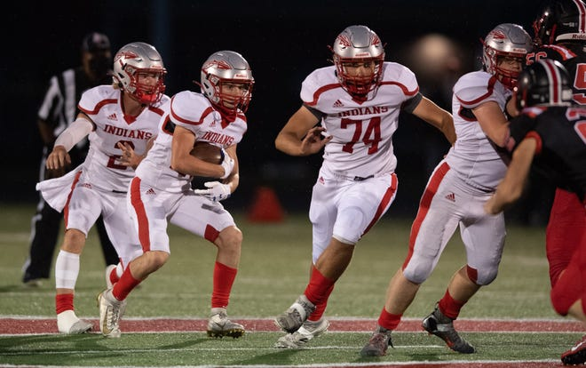 Northwest's Mason Kunkle (74) helps to lead the way on a run during the Indians' Week 1 win at Orrville.