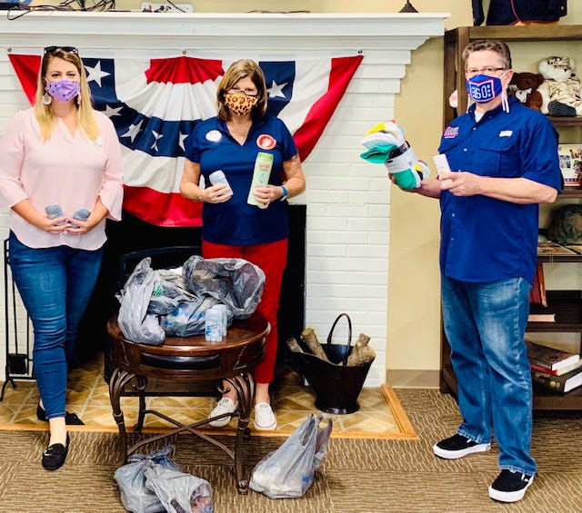 Donna Grady (center) makes a donation of toiletry items to the military on behalf of Xi Beta Upsilon. Accepting the donation for the USO in Jacksonville are from left; Megan Boggs, operation coordinator, and Jeff Weller, center operations and program coordinator. XBU is a service and social chapter of Beta Sigma Phi. Members in addition to Donna include Sandra Braxton, Lois Charlton, Nan Dale, Jan Fly, Cindy Mills, Jessica Shimer, Debbie Smith, Shelby Smith, Sandra Thompson and Diane Bowen. [CONTRIBUTED PHOTO]