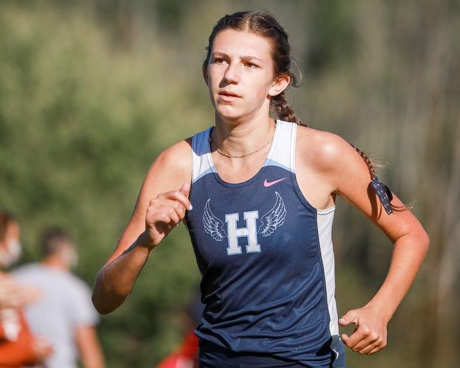 Hudson's Emmaline Hannan runs the course at Hudson Springs Park during a meet earlier this season.