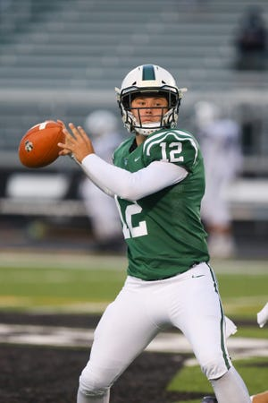 Aurora junior quarterback Alex Moore looks to pass during the Greenmen's 38-0 home win over Twinsburg Oct. 3.