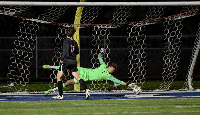 CVCA goaltender Carson Young makes a diving save during the Royals' 4-0 home loss to Hudson Oct. 3. Young made nine saves in the loss.