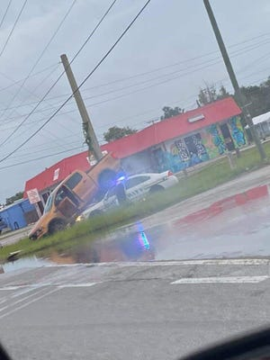 A suspect's truck wound up on top of a sheriff's patrol car after crashing while avoiding stopsticks in Auburndale.