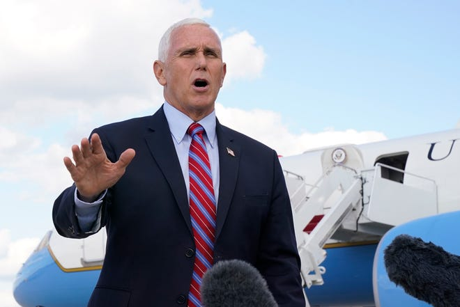 Vice President Mike Pence speaks to members of the media at Andrews Air Force Base, Md., Monday, Oct. 5, 2020, as he leaves Washington for Utah ahead of the vice presidential debate scheduled for Oct. 7.