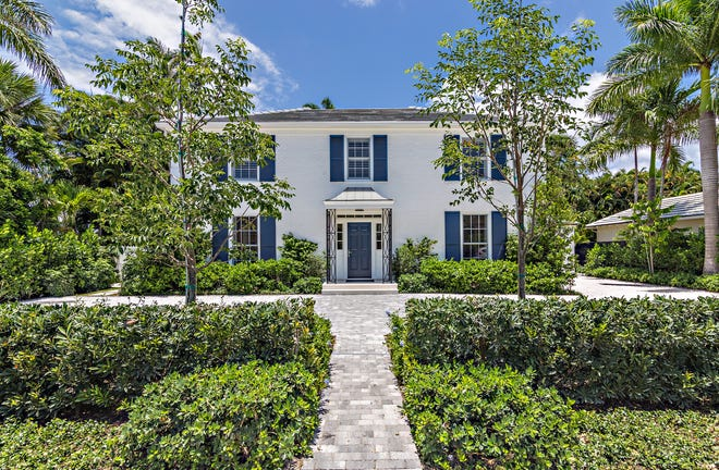 A recently remodeled house at 207 Pendleton Ave. in Palm Beach has been sold for a recorded $7.318 million by Betsy Sorrel, its developer.  The house was designed by noted society architect John L. Volk in 1952. [Photo by Giles Bradford, courtesy Sotheby's International Realty]