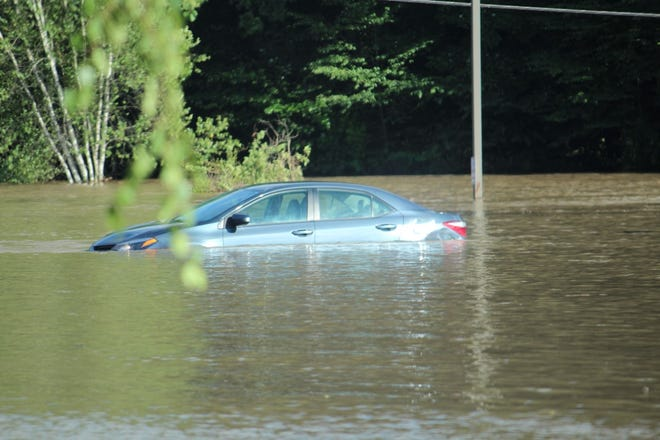 A vehicle submerged in floodwaters off Manor Drive in Snydersville after Tropical Storm Isaias made its way through the Poconos on Tuesday, Aug. 4.