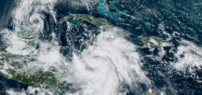 A fizzling Tropical Storm Gamma, left, and a strengthening Tropical Storm Delta. Delta is forecast to reach Category 3 hurricane strength before striking the Gulf Coast.