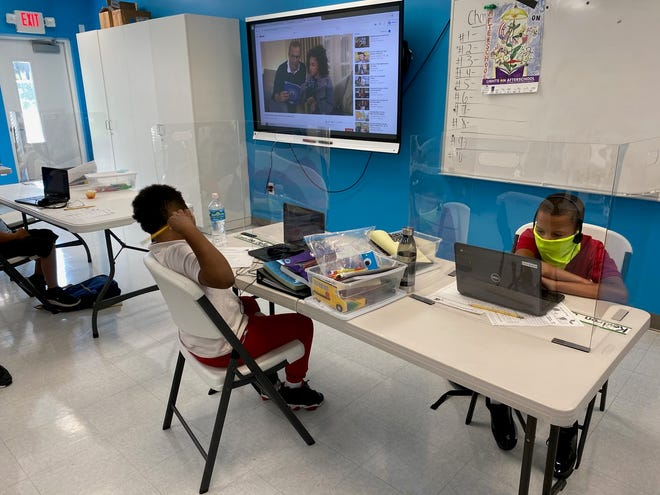 Children sit at their desks in one of the classrooms at the Edna W. Runner Tutorial Center.