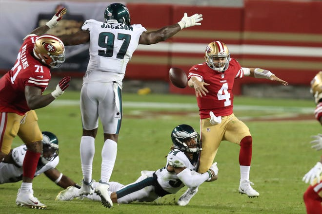 San Francisco 49ers quarterback Nick Mullens (4) fumbles the ball as he gets hit by Philadelphia Eagles cornerback Cre'von LeBlanc during the second half of Sunday's game at Levi's Stadium. Eagles defensive tackle Malik Jackson (97) made the recovery. [JED JACOBSOHN/THE ASSOCIATED PRESS]