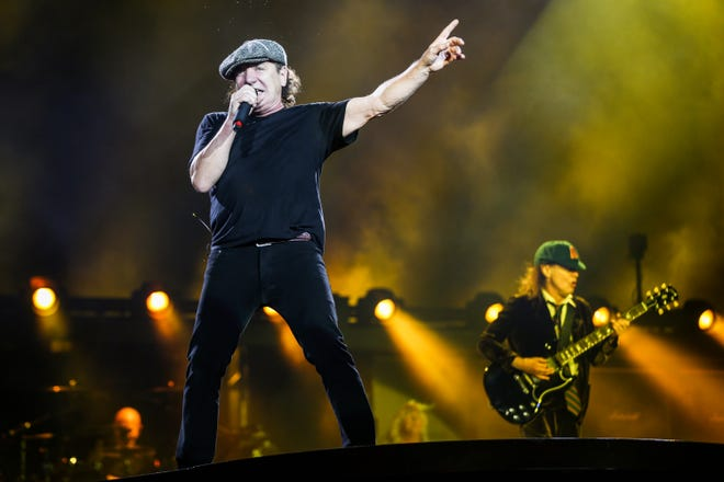 "Brian Johnson, left, and Angus Young of AC/DC perform during the final U.S. stop of their Rock Or Bust Tour at Dodger Stadium on Sept. 28, 2015, in Los Angeles. The band announced Monday that they will be releasing a new single titled ""Shot in the Dark"" later this week."