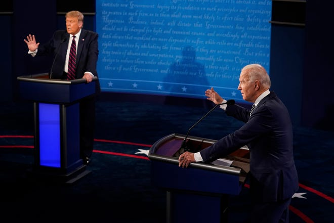 President Donald Trump and Democratic presidential candidate former Vice President Joe Biden exchange points during their first presidential debate on Sept. 29. The presidential race is tied in Florida with less than 30 days to go, according to a new Suffolk University/USA TODAY Network poll.