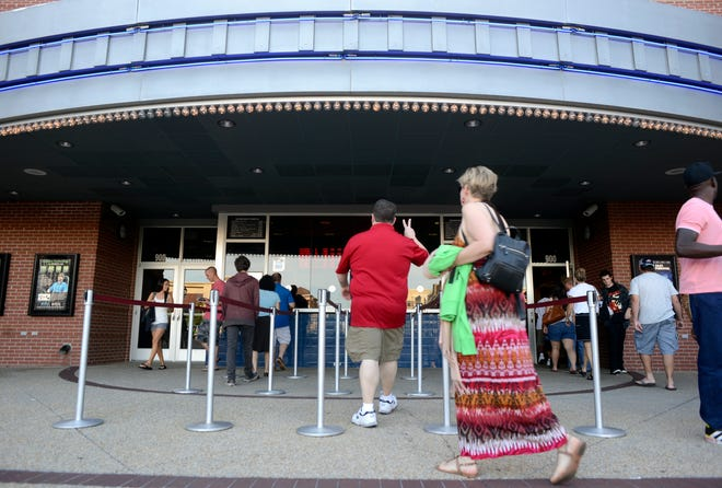 Movie-goers line up for tickets at Regal Mayfaire cinemas in 2013.