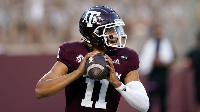 Texas A&M quarterback Kellen Mond put up big numbers but it wasn't nearly enough Saturday against Alabama. He completed 25 of 44 passes for 318 yards with three touchdowns — and a pick six.