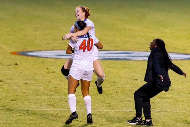 Florida forward Alivia Gonzalez (40) celebrates her game-winning goal Sunday with midfielder Cassidy Lindley (2) in beating Alabama at the Donald R. Dizney Stadium.