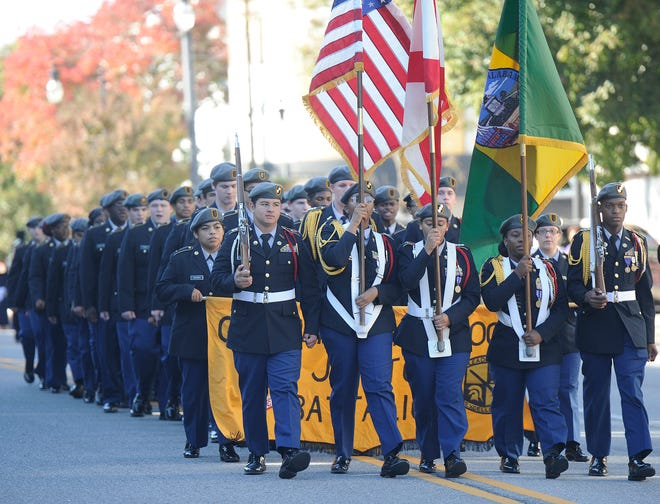 Members of the Gadsden City High JROTC lead the Gadsden-Etowah Veterans Parade down Broad Street on Nov. 6, 2019. The Gadsden-Etowah Patriots Association on Monday announced that the parade has been called off and the annual Patriots luncheon postponed until next spring because of the COVID-19 pandemic.