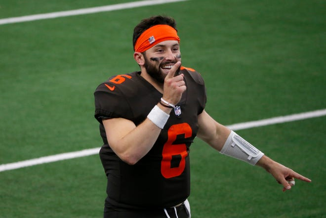 Cleveland Browns quarterback Baker Mayfield (6) celebrates on the field after their 49-38 win against the Dallas Cowboys in Arlington, Texas, Sunday, Oct. 4, 2020. Cleveland is a 3½-point underdog at Pittsburgh on Sunday. (AP Photo/Michael Ainsworth)