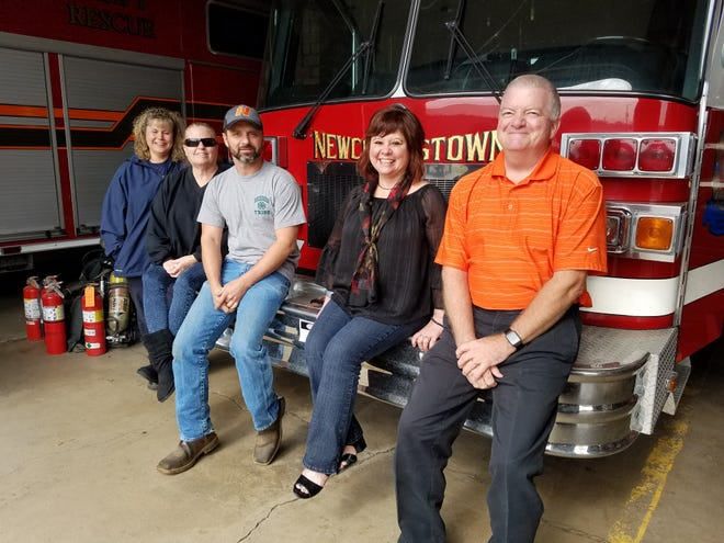 Firefighter/paramedic Heather Stein Wells (left) poses for a photo with four of the five members of the nonprofit governing board of the Newcomerstown Emergency Rescue Squad, Inc. Next to her are (left to right) Carol Harper, John Marstrell (president), Kristie Wilkin and Tom Sauerbrey. Not pictured is Jay Winkler.
