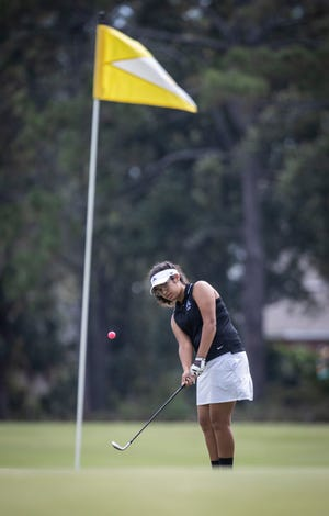 Arnold golfer Ridah September gets her ball up on the green. The Bay County girls high school golf tourney was held at Holiday Golf Club Monday, October 5, 2020.