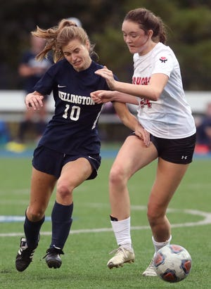 Wellington's Mary Morosky (left) battles Zanesville Rosecrans' Jenna McLaughlin for possession Sept. 30. Morosky, who recorded 22 goals and nine assists last season, had 18 goals and three assists through 10 games this season.