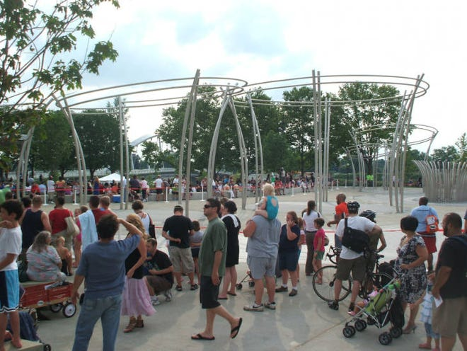 A crowd gathered around the Scioto Mile Fountain when it was turned on for the public for the first time. The opening show was held at 6 p.m. July 7, 2011. The 15,000-square-foot fountain contains more than 1,000 ground-level spray nozzles and five halo structures, with an additional 1,000 nozzles that shoot water 70 feet into the air. The fountain has been closed temporarily because of the COVID-19 coronavirus pandemic.