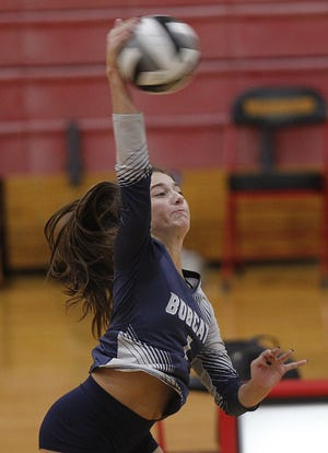 Grandview senior Hannah Yochem sends the ball over the net during a match at Worthington Christian on Sept. 29. A three-year starter in basketball, Yochem has found a second passion in volleyball as her skills and knowledge of the game have improved.