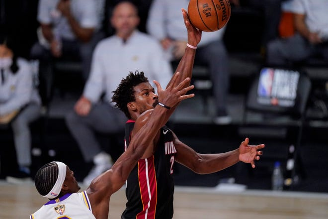 Miami Heat's Jimmy Butler shoots the ball during the second half of Game 3 of the NBA Finals against the Los Angeles Lakers, Sunday, Oct. 4, 2020, in Lake Buena Vista, Fla.