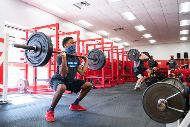 Erwin senior quarterback Korey Griffith works out with his teammates in the Erwin High School weight room on Oct. 1, 2020. Griffith transferred to Erwin from Pisgah to play out his senior year.