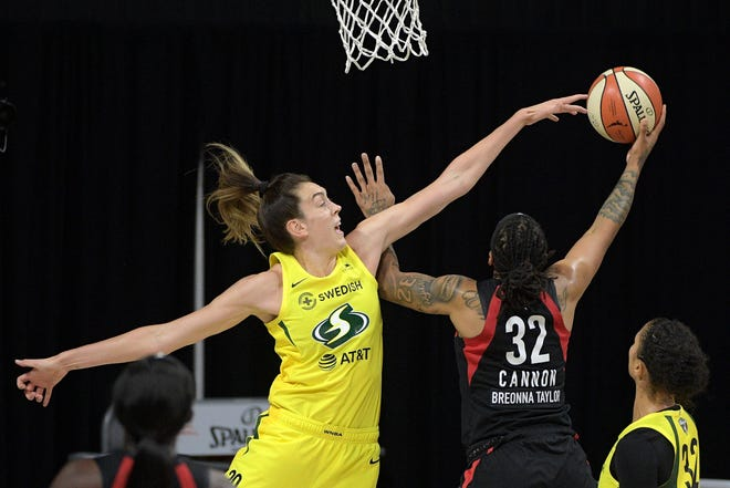 Las Vegas Aces forward Emma Cannon (32) goes up to shoot as Seattle Storm forward Breanna Stewart (30) defends during the second half of Game 2 of basketball's WNBA Finals, Sunday, Oct. 4, 2020, in Bradenton, Fla. (AP Photo/Phelan M. Ebenhack)