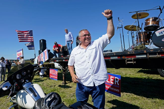 "Republican gubernatorial candidate Loren Culp smiles while greeting supporters as he arrives at a rally Saturday, Aug. 29, 2020, in Mount Vernon. Culp, police chief of the town of Republic and author of the book ""American Cop: Upholding the Constitution and Defending Your Right to Bear Arms,"" is running against incumbent Democratic Gov. Jay Inslee in November."