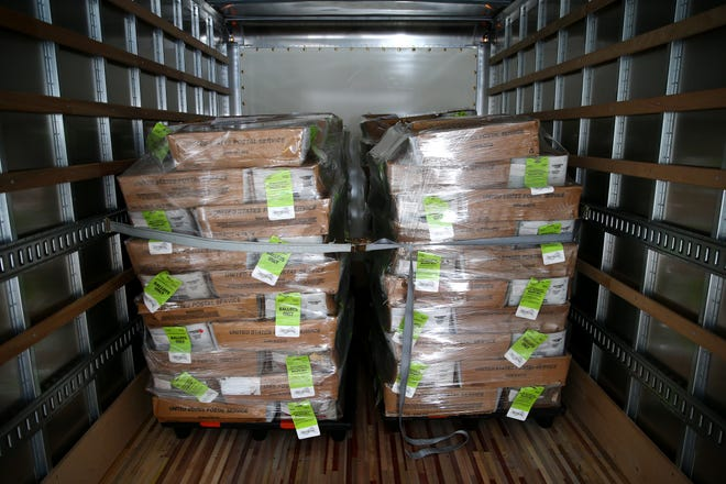 A truck-load full of prepared ballots ready to be mailed to voters is set to depart the Hamilton County Board of Elections for the main post office in downtown Cincinnati, Monday, Oct. 5, 2020.