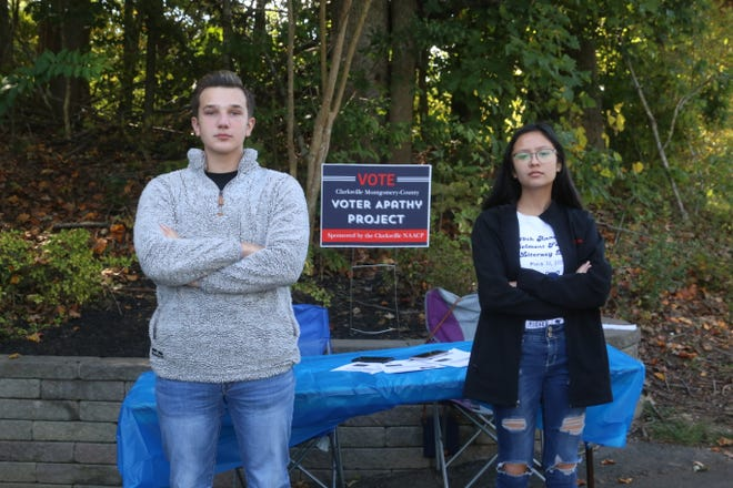 Tyler Rose, 16, of West Creek High School, stands with fellow volunteer Rianne Brown, 16, of Rossview High School, in front of their Clarksville-Montgomery County Voter Apathy Project table set up on the Clarksville Greenway on Sat., Oct. 3, 2020.