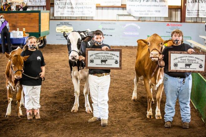 From left,  Grace Kilchenman (Progressive Livestock), Reserve Grand Champion Austin Yoder (Progressive Livestock) and the Grand Champion Dairy Female Hayden Kilchenman (Ridgewood FFA).