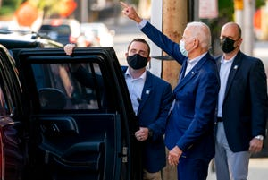 Democratic presidential candidate former Vice President Joe Biden leaves the Queen Theater after a virtual town hall, Saturday, Oct. 3, 2020, in Wilmington, Del.