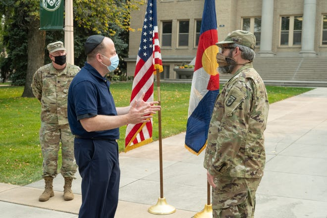 Colorado Gov. Jared Polis commissions Rabbi Yerachmiel Gorelik as a chaplain in the Colorado National Guard. October 2, 2020, on The Oval at Colorado State University.