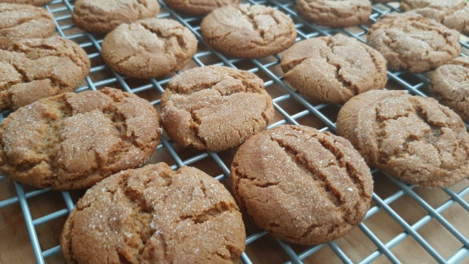 I suspect using shortening instead of butter creates fluffier molasses cookies with more cracked tops.