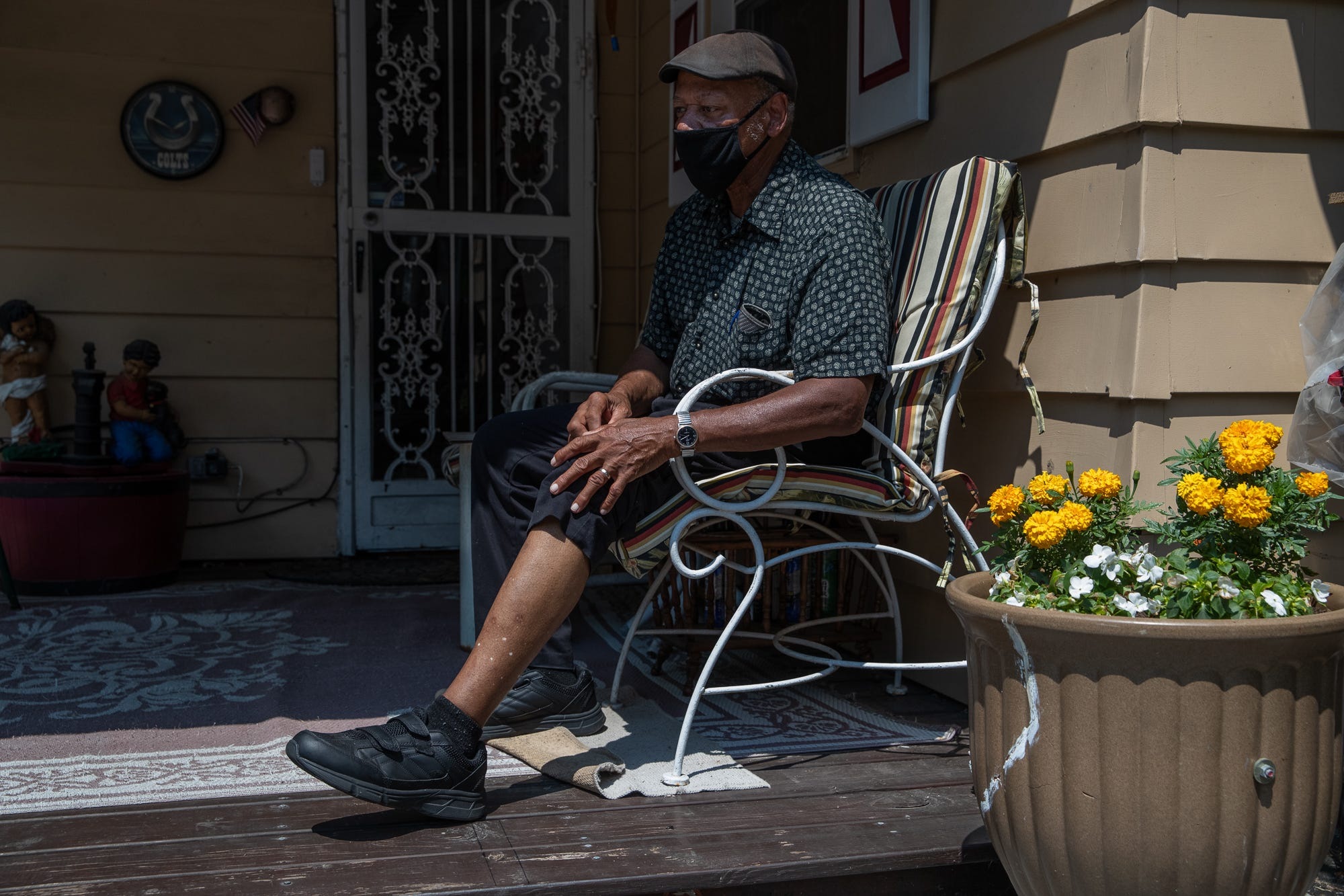 """Gordon Mitchum Sr., 78, of Indianapolis, a retired mail handler of 43 years, pulls up his left pant leg to show the scars left by an Indianapolis Metropolitan Police Department dog bite, at his home on Monday, July 6, 2020. Mitchum says he was given no warning when an IMPD K-9 officer entered his yard to search for possible suspects in a carjacking after a chase that ended on Mitchum's street. """"I was sitting here in this chair,"""" he said. """"And by the time I could see that dog, I could tell he was on a leash, but he came around and all at once he grabbed my leg."""" Mitchum ended up on his back on the ground when the dog let go. The dog then grabbed onto his right foot."""