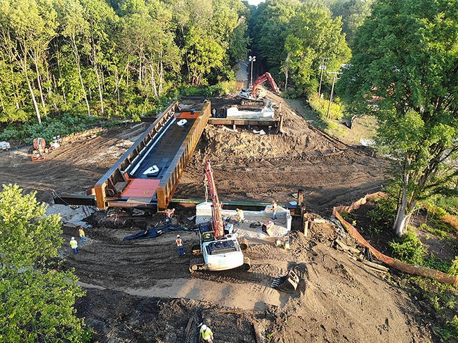 The railroad bridge and arched, stone underpass on Newman Road, just west of Indiana 26, has been demolished, and the new bridge is being installed. Work is expected to continue through fall 2020.