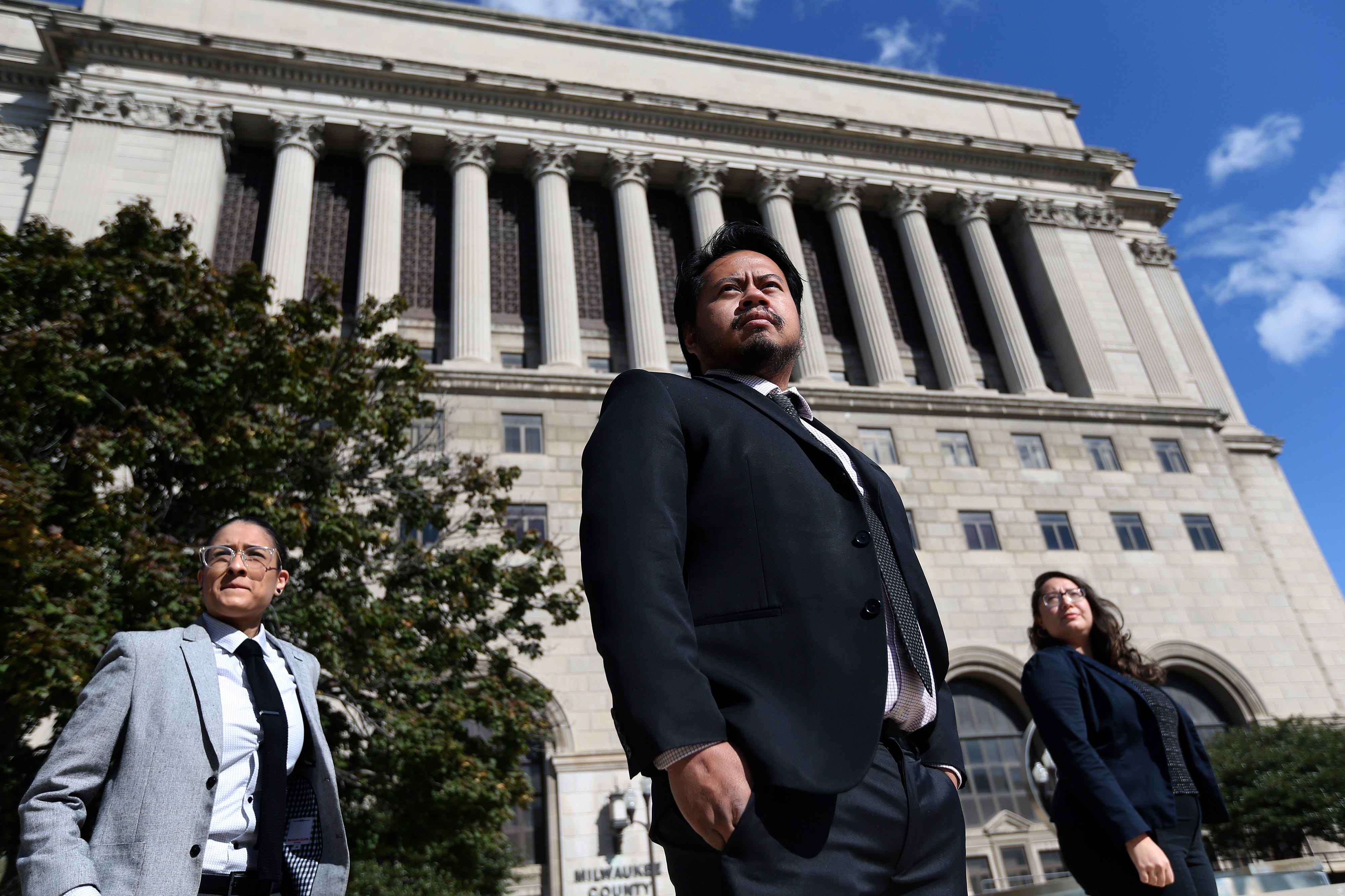 Staff from the Legal Action of Wisconsin Eviction Defense Project, from left, Jocelyn Gallegos, paralegal; Raphael Ramos, project director; and Sofia Ascorbe, assistant director and staff attorney, are photographed in front of the Milwaukee County Courthouse on Oct. 2, 2020.
