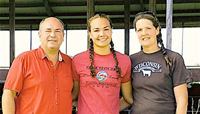 Duane and  Tina Hinchley and daughter Anna Hinchley Skadahl run Hinchley's Dairy Farm in Cambridge. Anna graduated from UW-Madison in May.