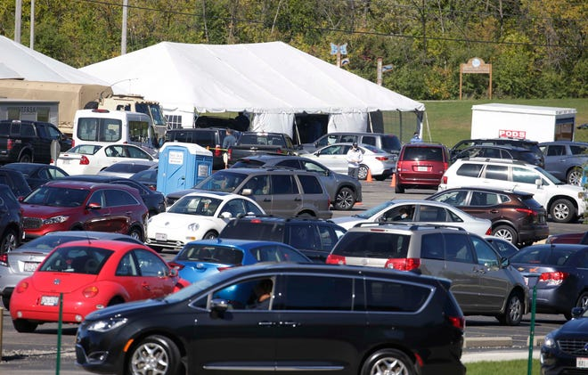 Vehicles were backed up more than four blocks to get in line for COVID-19 testing at the UMOS Inc. site at 2701 S. Chase Ave. on Monday.