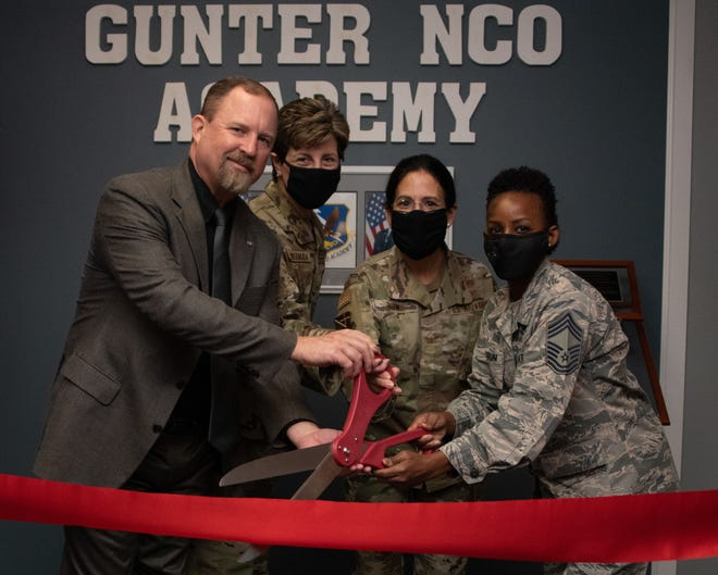 Left to right, Toxie Robbins, former Gunter Noncommissioned Officer Academy commandant, Chief Master Sgt. Tracie Timmerman, Thomas N. Barnes Center for Enlisted Education command chief, Col. Kathryn Brown, Barnes Center commander, and Chief Master Sgt. Rosita Goodrum, Gunter NCOA commandant cut a ribbon at the reopening ceremony for the Gunter NCOA Oct. 1, 2020, Maxwell-Gunter Annex, Alabama. Gunter NCOA's close proximity to the Thomas N. Barnes Center for Enlisted Education makes the academy an ideal host site for new EPME initiatives and allows instructional system designers to test curriculum in real time before they are implemented throughout all Air Force NCO academies.