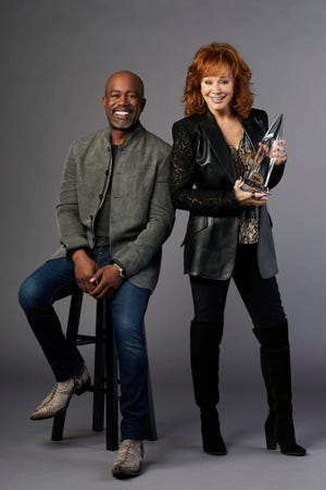 Darius Rucker, left, and Reba McEntire will host the CMA Awards on Nov. 11.