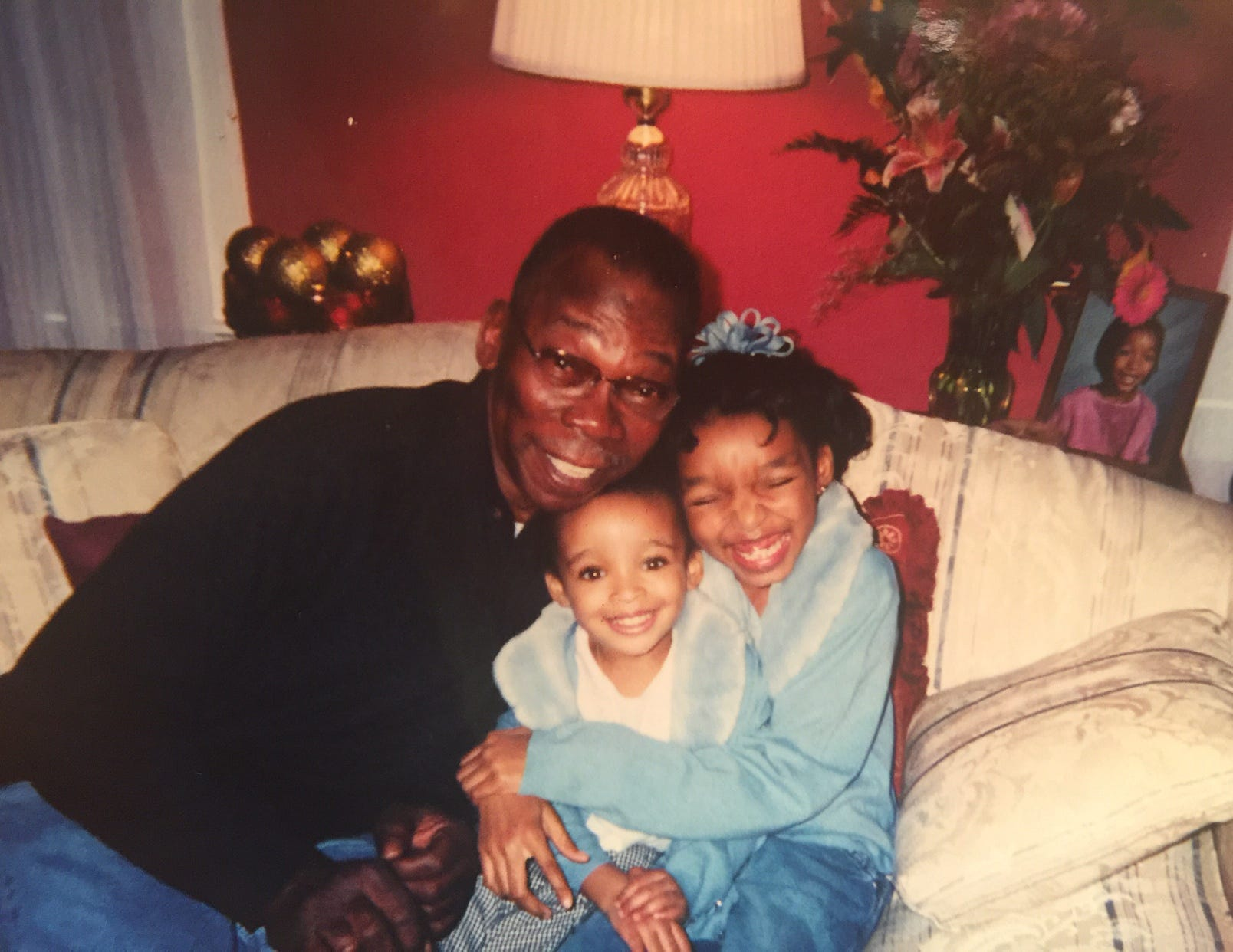 Shaylah Brown spending the afternoon at her grandparents' house in 2002 on Maple Avenue in Hillside, New Jersey, sitting with her grandfather and younger sister Brianna.